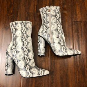 Fashion nova snake print boots, 4 inches, size 7.